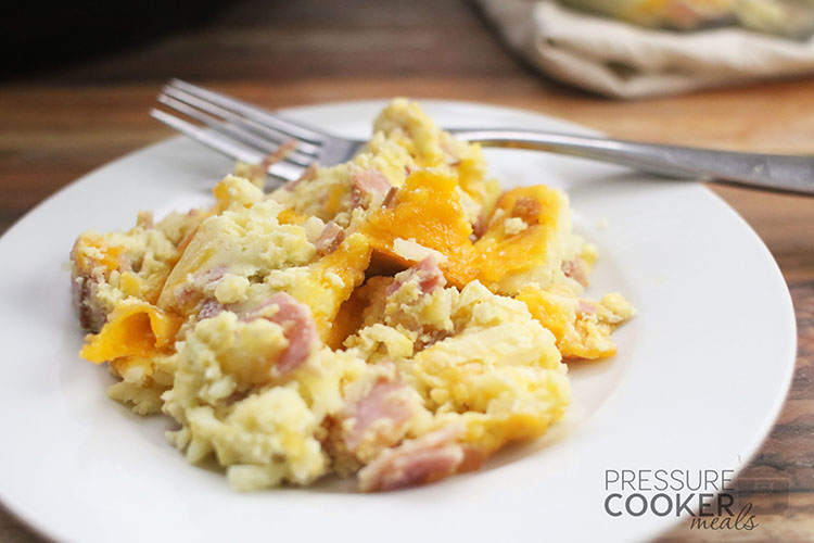 Instant Pot Breakfast Casserole with Ham and Egg on white plate with fork