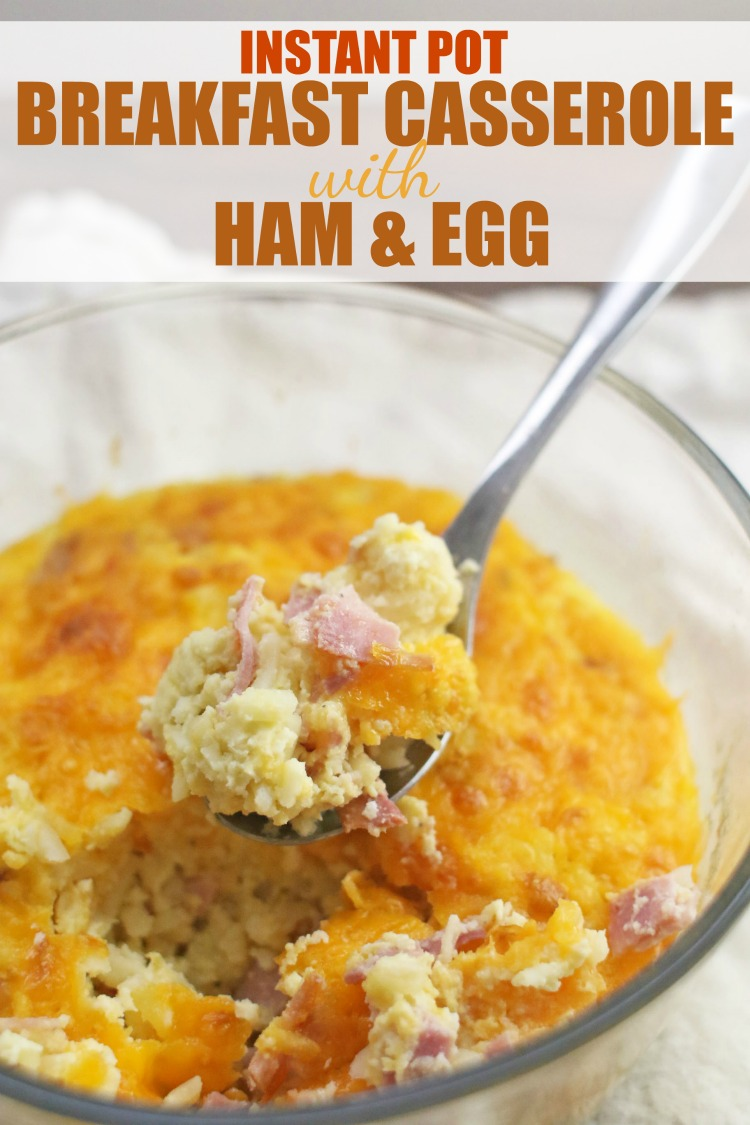 Instant Pot Breakfast Casserole with Ham & Egg in a clear bowl with a spoon dipping