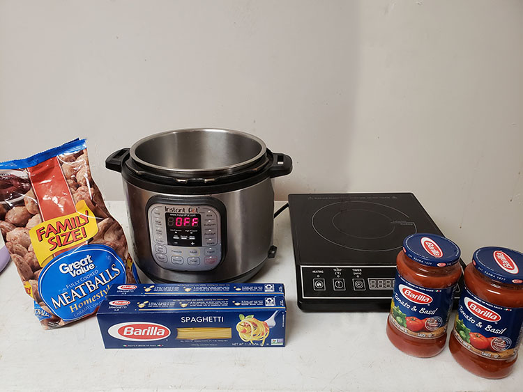 Easy Instant Pot Spaghetti & Meatballs recipe ingredients with an instant pot and electric burner on a table