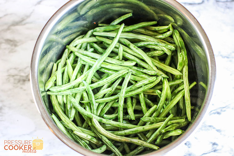 fresh green beans in the Instant Pot pot on the counter